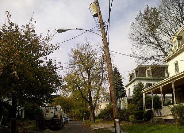 <p><p>A lightpost on Independence Street in East Oak Lane took a beating in the storm. (Brian Hickey/WHYY)</p></p>