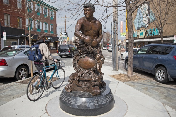 This statue at the junction of East Passyunk Avenue and Mifflin and 13th streets honors South Philly boxer Joseph Giardello. (Lindsay Lazarski/WHYY)