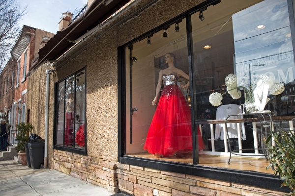 Mia's of Philadelphia at Moore Street and East Passyunk Avenue displays prom dresses in the boutique windows. (Lindsay Lazarski/WHYY)