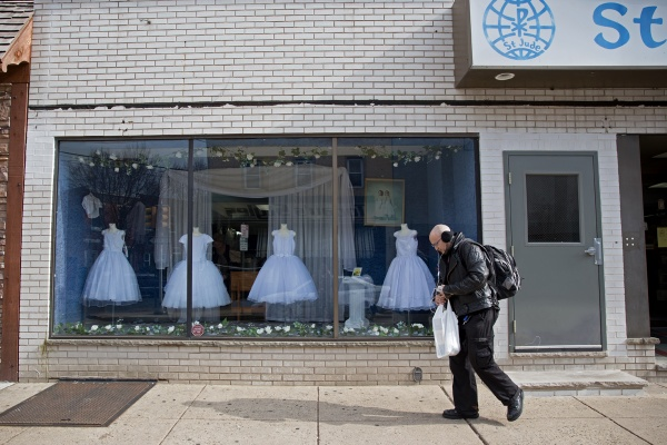 First Communion dresses adorn the window at St. Jude Shop, Inc. on East Passyunk Avenue. (Lindsay Lazarski/WHYY)