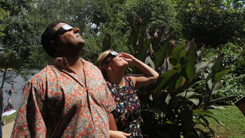 Jordan and Deb Desai view the 2017 solar eclipse in Columbia, South Carolina. (Kimberly Paynter/WHYY)