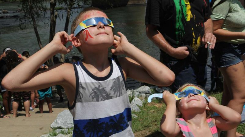 Logan and Chelsea Mills view the total solar eclipse in Columbia, South Carolina. (Kimberly Paynter/WHYY)