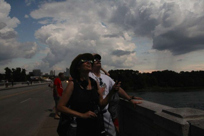 People gather on the Gervais Bridge in Columbia, South Carolina, during the 2017 total solar eclipse. (Kimberly Paynter/WHYY)