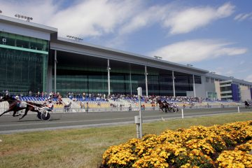 Harness racers pass the finish line at Harrah's Casino & Racetrack in Chester, Pa. Harrah's Philadelphia is located in a Keystone Opportunity Zone.  The casino and racetrack was exempt from state and local taxes from 2006 through 2013. (AP Photo/George Widman)