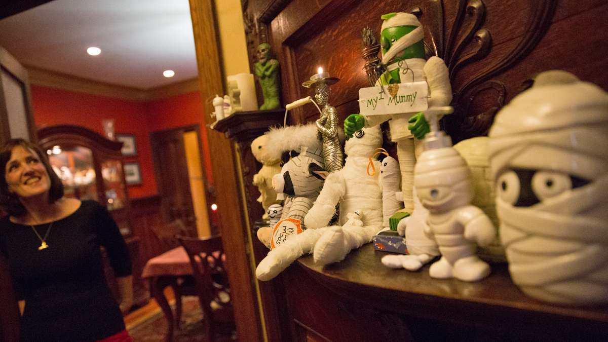 Halloween is an important holiday in the Wegner household, the display on the mantel is just a small sampling of their mummy collection, said Jennifer.  (Lindsay Lazarski/WHYY)