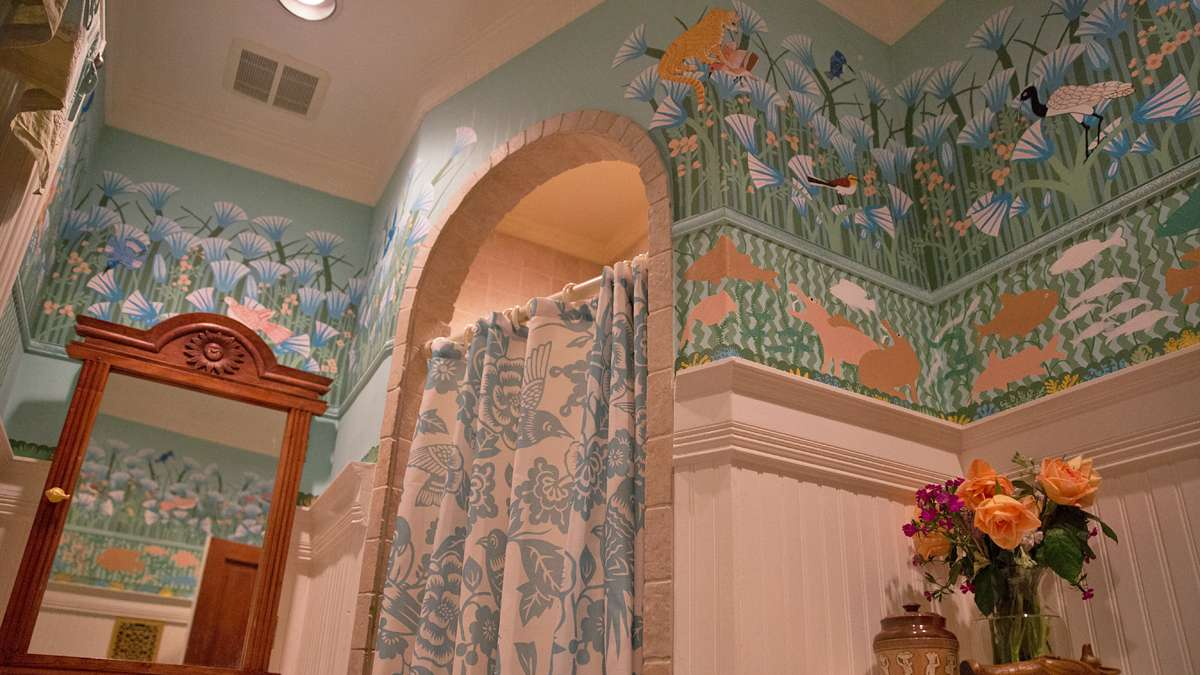 Josef hand-painted a mural of the banks of the Nile with birds and lotus flowers on the bathroom wall.  (Lindsay Lazarski/WHYY)