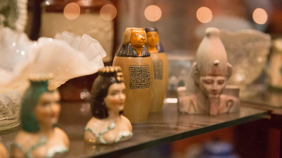On Friday, the Penn Museum celebrates 100 years of the sphinx, a mythological creature without the body of a lion and human like head.  Many of the Wegners' kitschy sphinxes will also be on display at the museum.  (Lindsay Lazarski/WHYY)