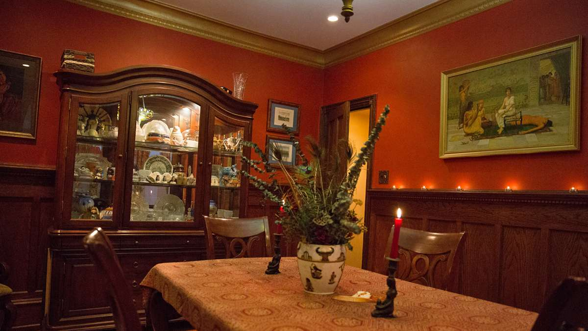 The Wagners display Egyptian art and a curio cabinet with whimsical knick-knacks in their dining room. (Lindsay Lazarski/WHYY)