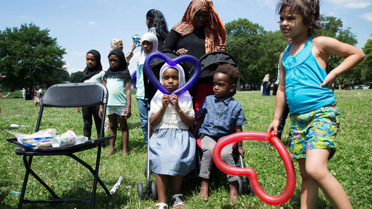 Children wait for balloon animals at Eid al-Fitr festivities in FDR Park