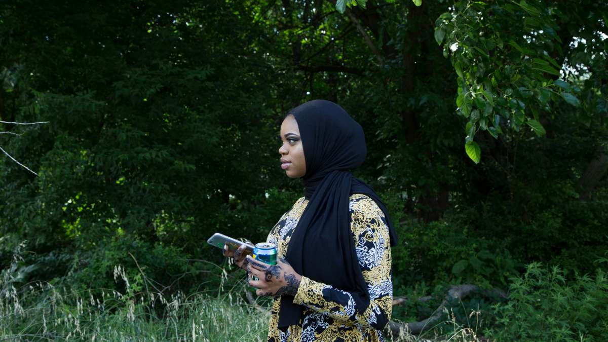 Sumayyah speaks to her brothers at Eid al-Fitr festivities in FDR Park