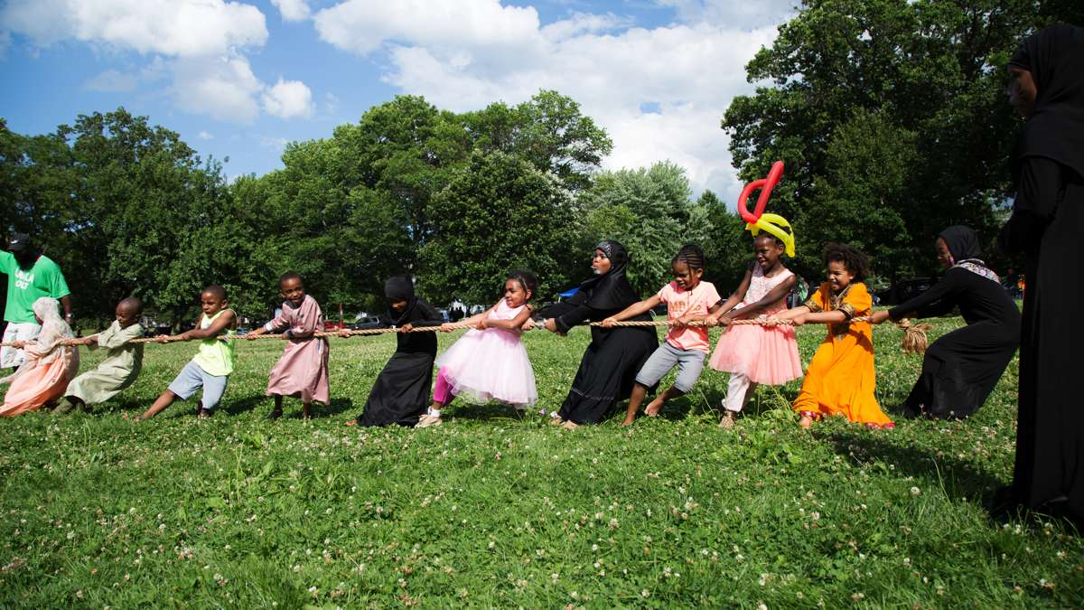 Children play a game of tug of war at Eid al-Fitr festivities in FDR Park