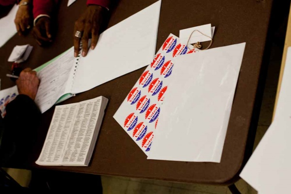 "<p><p>""I Voted"" stickers sit on a table at the Awbury Recreation Center in Germantown Tuesday morning. (Brad Larrison/For NewsWorks)</p></p>"