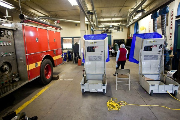"<p><p><span style=""font-size: 12pt; line-height: 115%; font-family: 'Helvetica','sans-serif';"">Voters and poll workers at Fire Engine #37 in Chestnut Hill Tuesday. (Brad Larrison/ for NewsWorks)</span></p></p>"