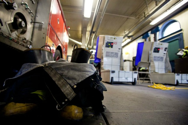 "<p><p><span style=""font-size: 12pt; line-height: 115%; font-family: 'Helvetica','sans-serif';"">Firefighter boots rest behind the polling stations at Fire Engine #37 in Chestnut Hill Tuesday. (Brad Larrison/ for NewsWorks)</span></p></p>"