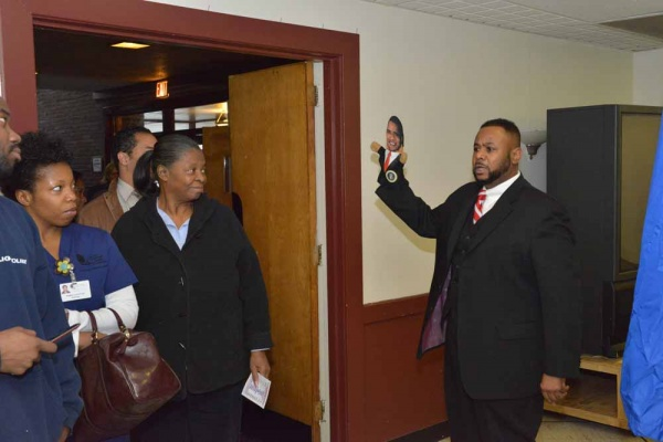 "<p><p>Councilman Curtis Jones, Jr. chants ""fired up and ready to go"" to voters while holding an Obama hand puppet at Pinn Memorial Baptist Church. (Bas Slabbers/for NewsWorks)</p></p>"