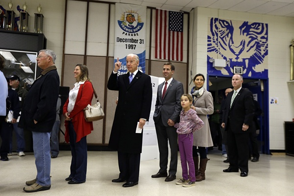 <p>Vice President Joe Biden, accompanied by his son Beau Biden, his wife, Hallie and their daughter Natalie, stands in line to cast his ballot at Alexis I. duPont High School, Tuesday, Nov. 6, 2012, in Greenville, Del. (AP Photo/Matt Rourke)</p>