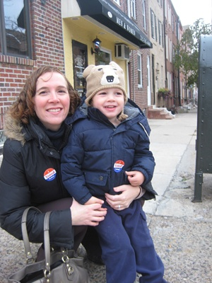 <p>Sarah Graden took along son Owen, 3, to vote at the VA meeting hall in Fairmount. (Maiken Scott/WHYY)</p>