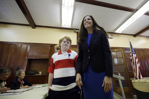 <p>Kathleen Kane, democratic candidate for Pennsylvania Attorney General, right, walks with her son Chris Kane, 11, as she prepares to vote at a polling place in the Waverly Community House, Tuesday, Nov. 6, 2012, in Waverly, Pa. (AP Photo/Matt Slocum)</p>