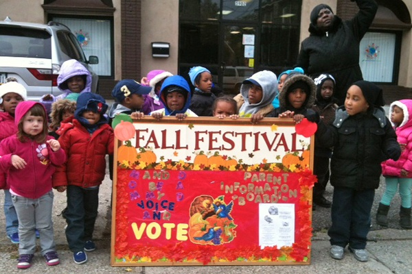 <p>Children from?Arising Futures Child Care and Development Center urge passers by to vote at Green and Rittenhouse Streets in Germantown.  (Shai Ben-Yaacov/WHYY)</p>