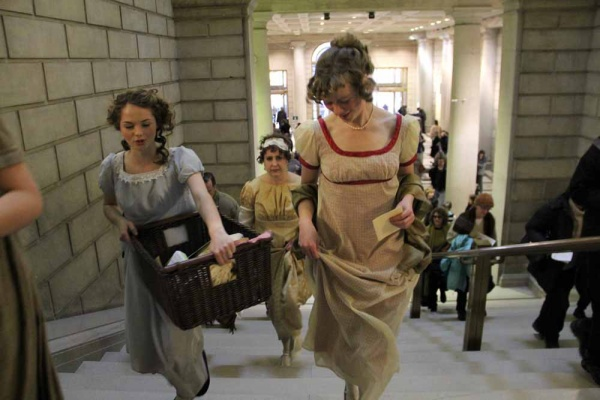 "<p><p>Old Academy Players carry their props from location to location during a series of pop-up performances of scenes from ""Pride and Prejudice."" (Emma Lee/for NewsWorks)</p></p>"