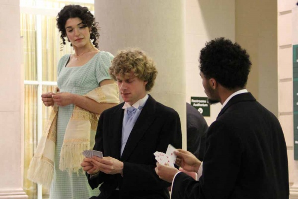 <p><p>Elizabeth Bennet, portrayed by Julia Wise, interrupts a card game between Mr. Bingley (Frederick Brown) and Mr. Darcy (Isaiah Price). (Emma Lee/for NewsWorks)</p></p>