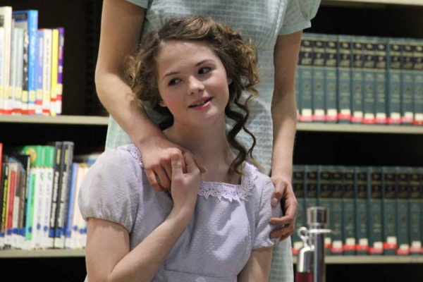"<p><p>Kitty (Jessica Hobbs-Pifer) dreams of wedded bliss during the Old Academy Players performance of ""Pride and Prejudice"" at the Free Public Library. (Emma Lee/for NewsWorks)</p></p>"