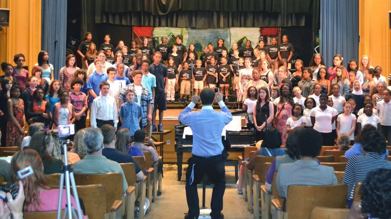 Nick D'Orsaneo directs all the choirs for the grand finale of the Roxborough Regional Choral Music Festival. (Joel B. Frady for NewsWorks)