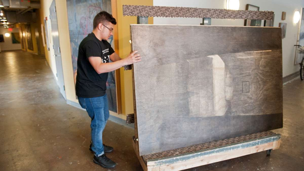Diego Rodriguez Carrion moves his paintings from his studio to the gallery.