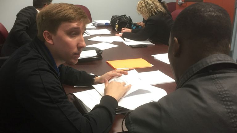 Two men talk at the expungement clinic in Dover Monday afternoon. (Zoe Read/WHYY)