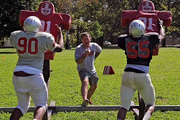 Mustangs coach John Sullivan runs a summer practice at Dobbins-Randolph Vo-Tech High School.