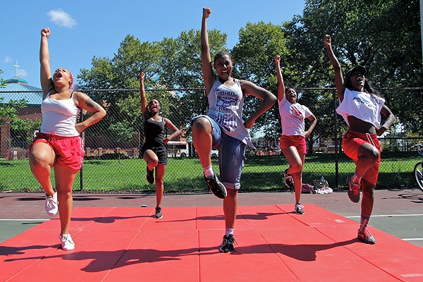 Shatoni Caldwell leads the Dobbins-Randolph Vo-Tech High School competitive spirit cheer team during a summer practice on the tennis courts at Reyburn Park.