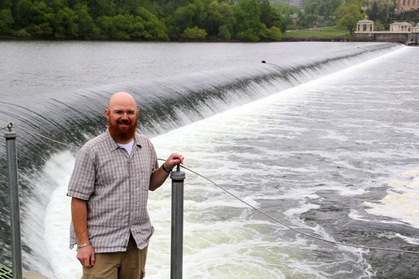 Fisheries biologist Joe Perillo stands above the Fairmount Dam. A nearby fish ladder helps fish such as the American shad reach their spawning grounds upriver. (Emma Lee/for NewsWorks)