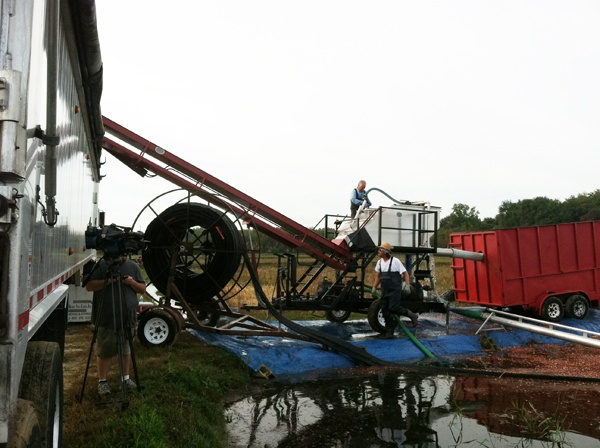 <p>Cranberry grower Tim Johnson washes and sorts berries. Good berries go to the left into an 18-wheeler, bad ones go into the red container on right.</p>