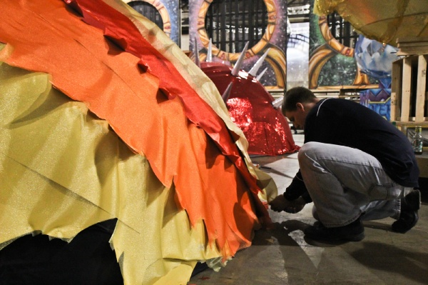 <p>Rich Francis of the Downtowners Fancy Brigade works on the planet Mercury for their 2013 theme, Birth of the Planets. (Kimberly Paynter/WHYY)</p>