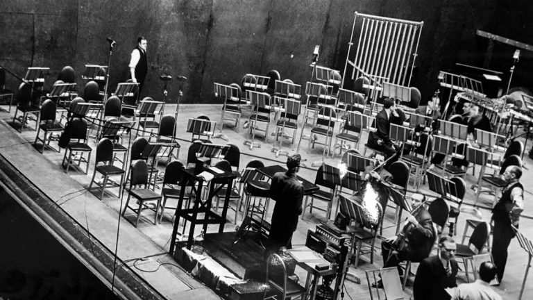 Engineers and musicians set up on stage at the Academy of music in Philadelphia in 1939, to record music for the 1940 film Fantasia. RCA's John Volkmann is pictured in the lower right, facing the camera. (Courtesy of Jesse Klapholz)