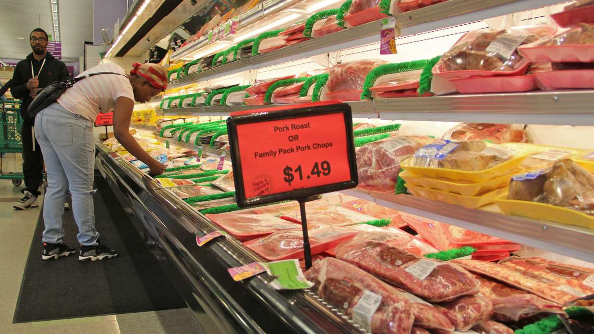 Chris and Kyisha Smith of Chester make selections from the meat aisle. (Emma Lee/WHYY)