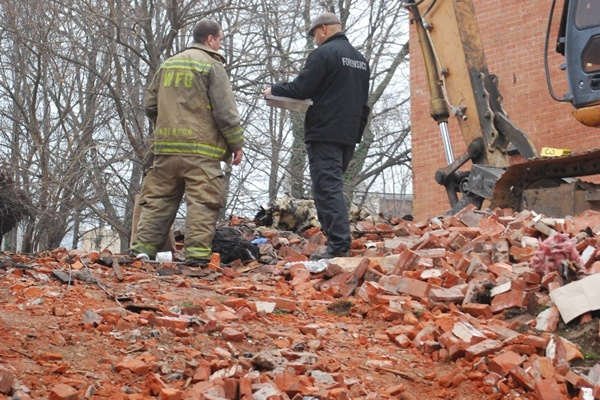 <p><p>Investigators stand among the rubble of the the W. 5th Street house that partially-collapsed during a fire on December 13. (John Jankowski/for NewsWorks)</p></p>