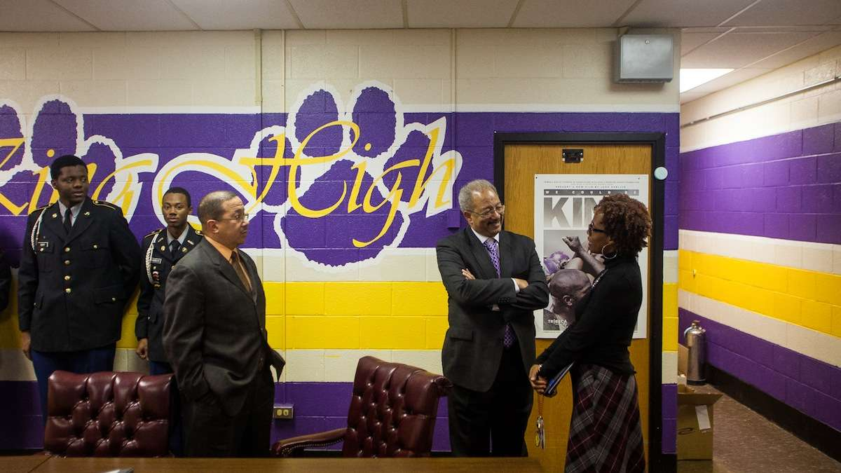 U.S Rep. Chaka Fattah greets MLK High Instructional Specialist Taara Green during a Monday morning visit and tour of the school. (Brad Larrison/for NewsWorks)