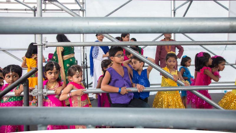 Dancers wait for their turn on stage during the Festival of India at Penn's Landing. (Emily Cohen for NewsWorks)