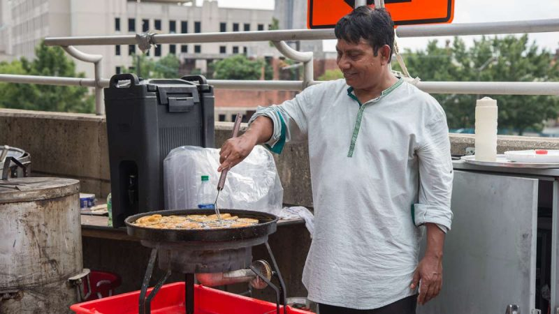 A man makes Jalebi, an Indian version of funnel cake, at the Festival of India at Penn's Landing. (Emily Cohen for NewsWorks)