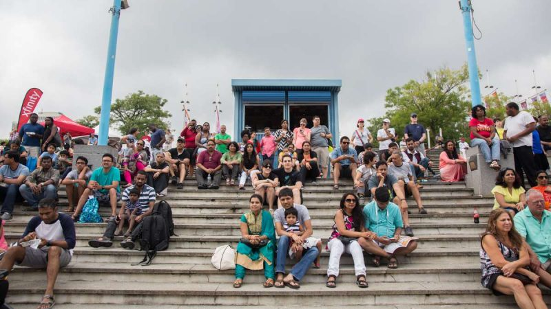 A crowd gathers on the steps to watch the dancers at the Festival of India at Penn's Landing. (Emily Cohen for NewsWorks)