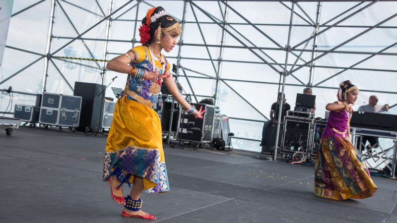 Dancers perform with their bare feet painted to resemble red shoes during the Festival of India at Penn's Landing Saturday, Aug. 12, 2017. (Emily Cohen for NewsWorks)