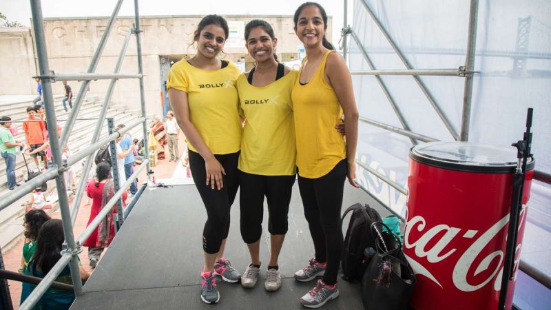 Performers (from left) Varsha Balu, 30, Teens Varghese, 26, and Ithi Joshi, 26, pose before showing off their BollyX excercise routine which they describe as Zumba meets Bollywood. They teach the class in Philadelphia and West Chester. (Emily Cohen for NewsWorks)
