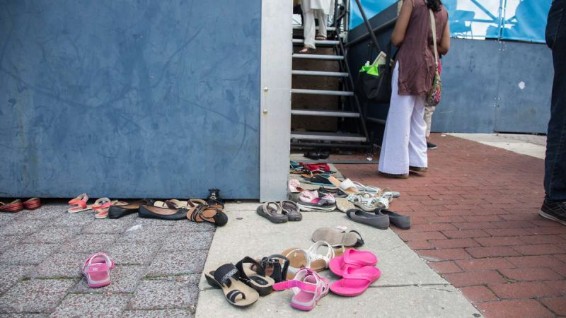 Dancers leave their shoes behind before they take the stage at the Festival of India at Penn's Landing. (Emily Cohen for NewsWorks)