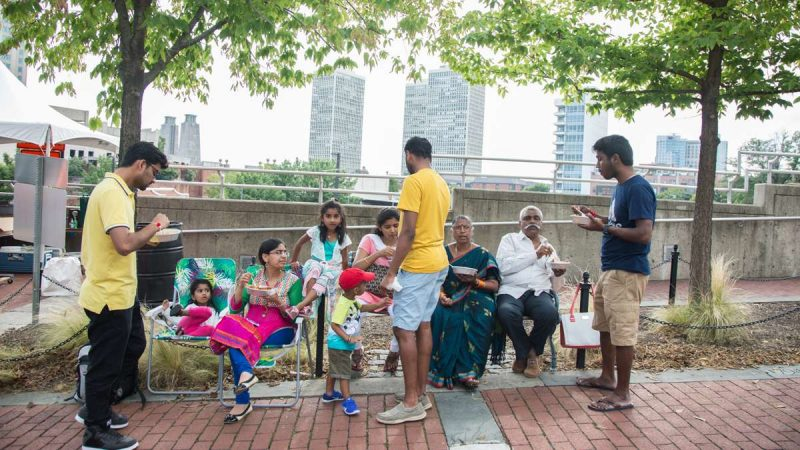 A family gathers at Penn's Landing for the Festival of India, a celebration 70th anniversary of India's independence from the British Empire. (Emily Cohen for NewsWorks)