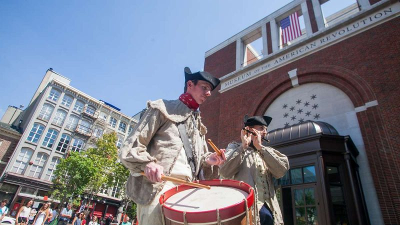 Fife player Matthew Skic and drummer Keith Henning perform songs from the Revolutionary War Saturday outside the Museum of the American Revolution. (Brad Larrison for NewsWorks)