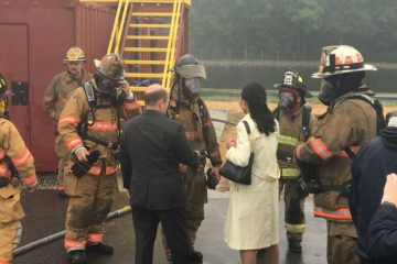 Sen. Chris Coons and Congresswoman Lisa Blunt Rochester talk to firefighters at Delaware State Fire School in Dover. (photo courtesy DSFS)