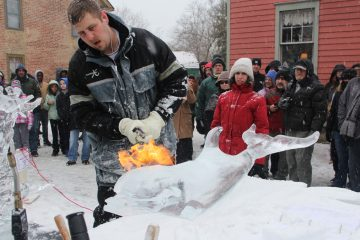 A blast of heat from Gerald Ford leaves the carved ice clear and smooth. (Emma Lee/for NewsWorks)