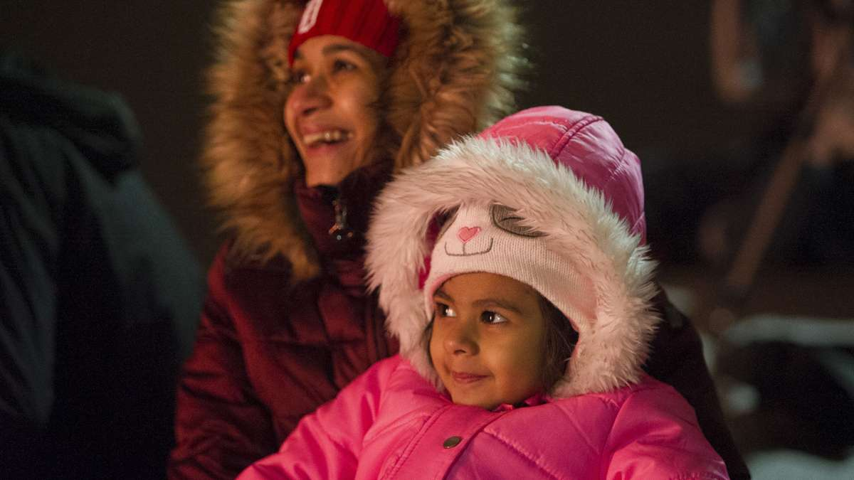 Yamini Varshney and her daughter Manushree Bahree enjoy the finale of the midnight display of the New Year's fireworks at Penn's Landing.