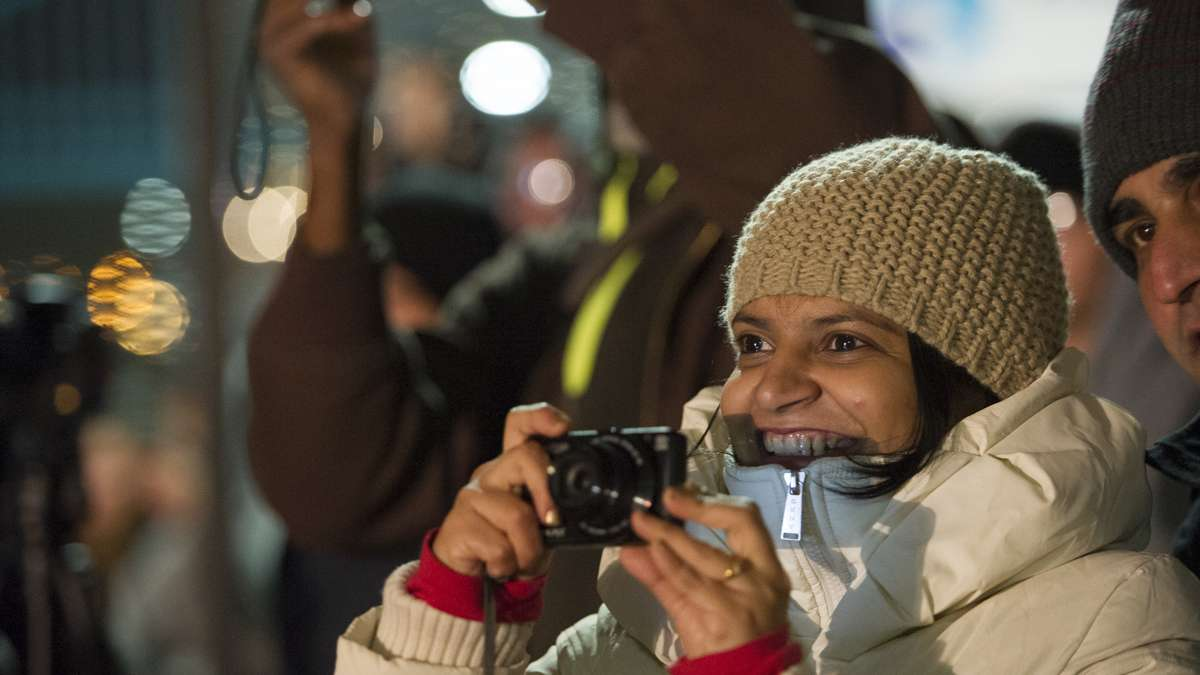 Priti Navelcar photographs the finale of the midnight fireworks display from Penn's Landing.